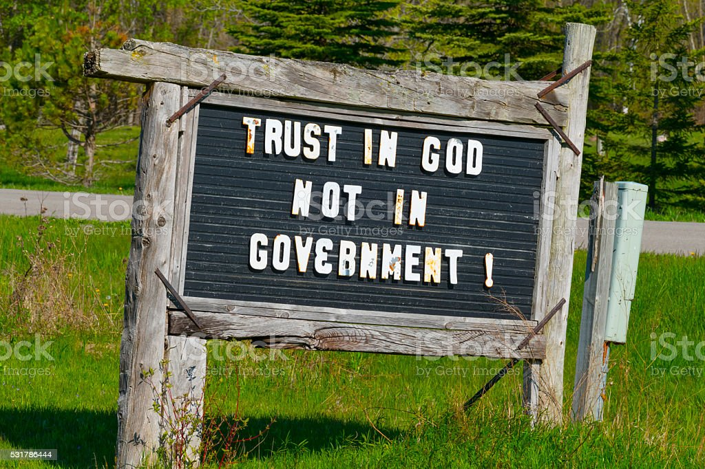 Trust in God not in Government sign. stock photo