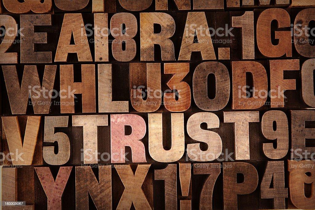 Trust - Letterpress letters stock photo
