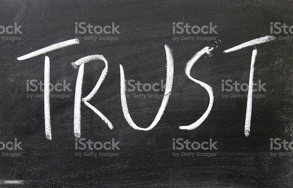 trust title written with chalk on blackboard royalty-free stock photo