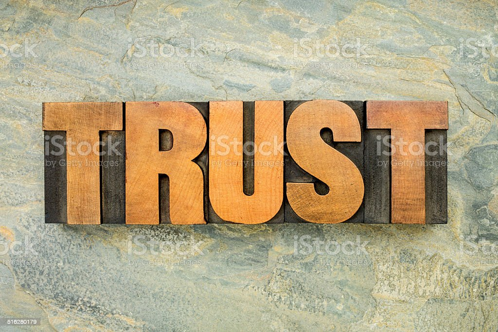 trust word in wood type stock photo