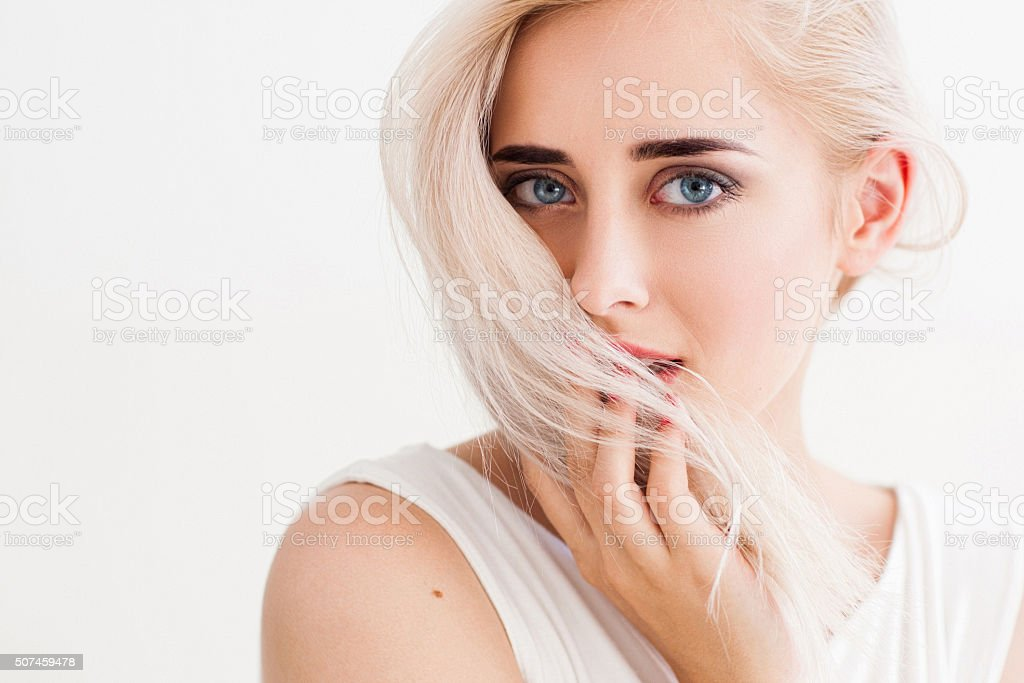 trustful and shy woman with blonde hair stock photo