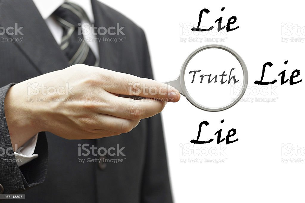 truth and lie concept with businessman holding magnifying glass stock photo