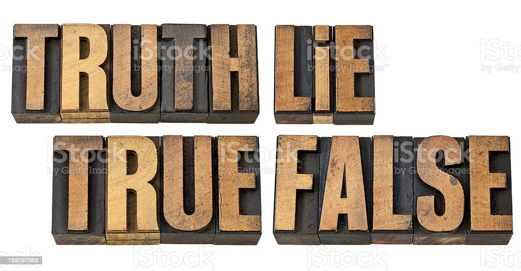 truth, lie, true and false in wood type royalty-free stock photo