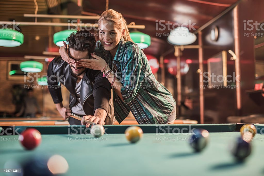 Try to hit the ball with your eyes closed! stock photo