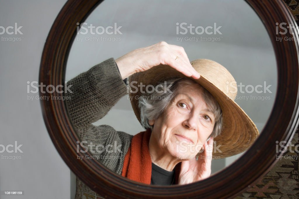 Trying on a Hat.5 stock photo