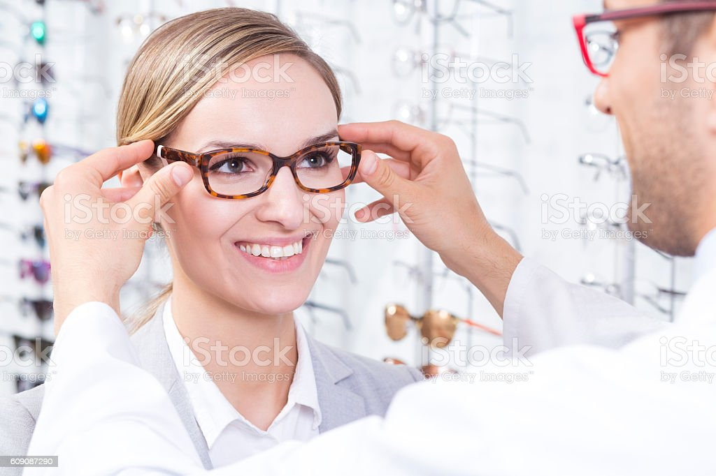 Trying on glasses stock photo