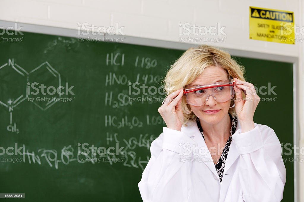 Trying on safety glasses royalty-free stock photo
