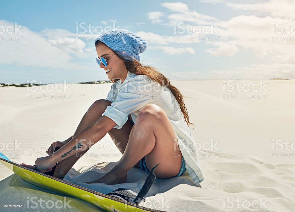 Trying out sand boarding for the very first time stock photo