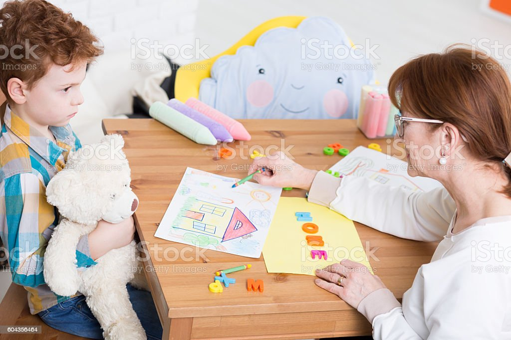 Trying to build trust in an autistic child stock photo