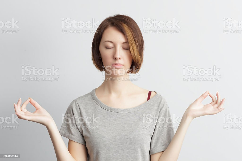 Trying to calm down.Girl holding finger together, position for stock photo