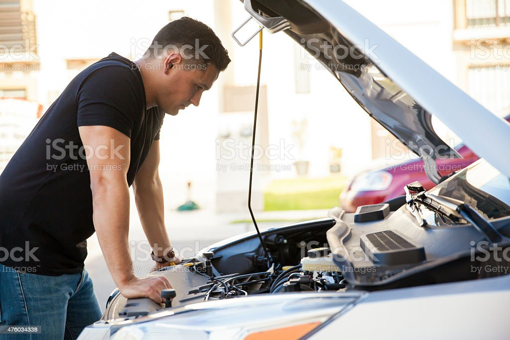 Trying to fix my car stock photo