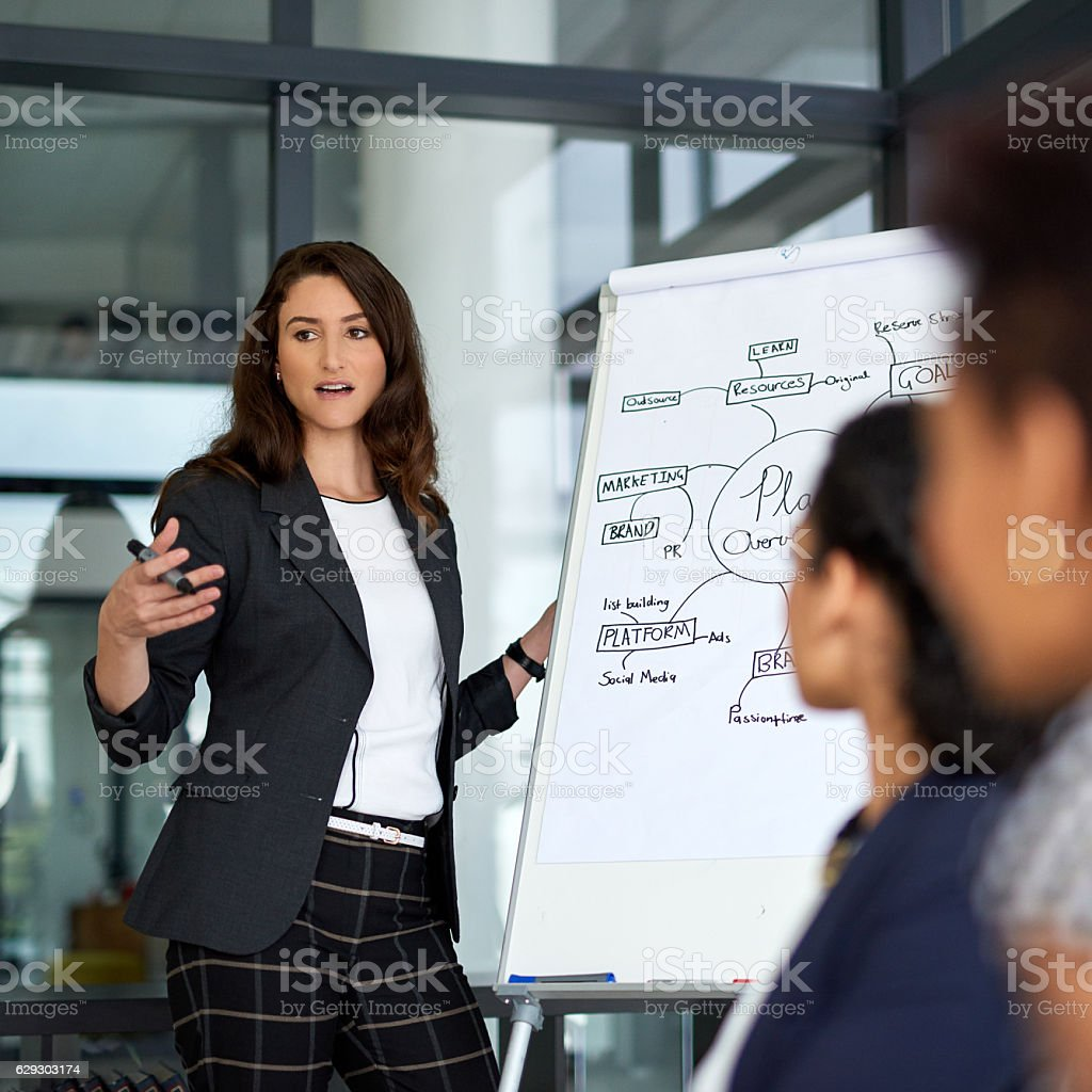 Trying to get her plan across stock photo