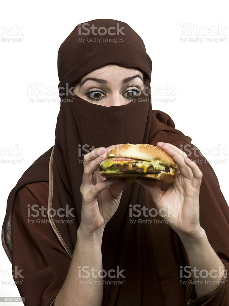 Trying to have a hamburger stock photo