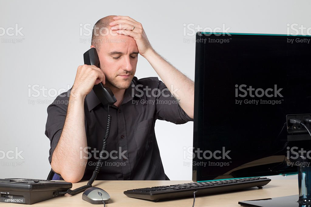 Trying to help over the phone stock photo