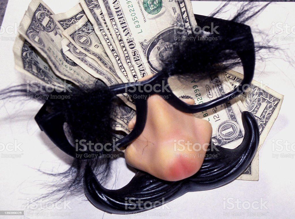 trying to hide money royalty-free stock photo