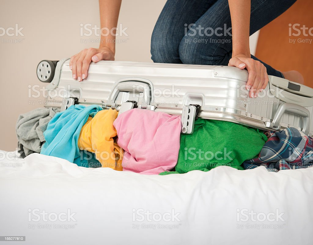 Trying to pack the Suitcase royalty-free stock photo