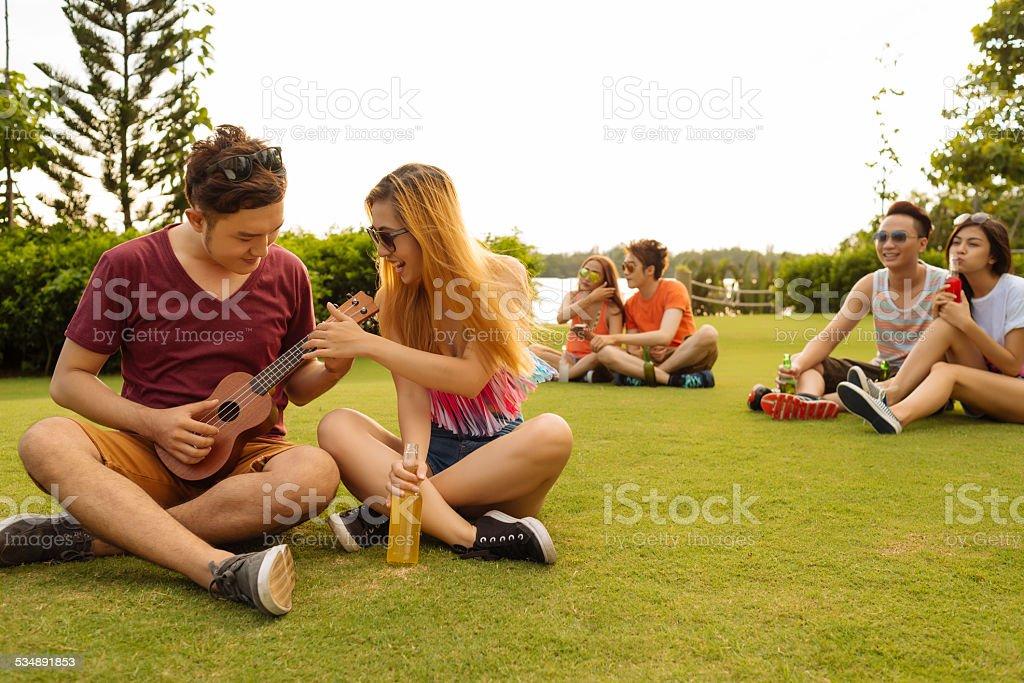 Trying to play ukulele stock photo