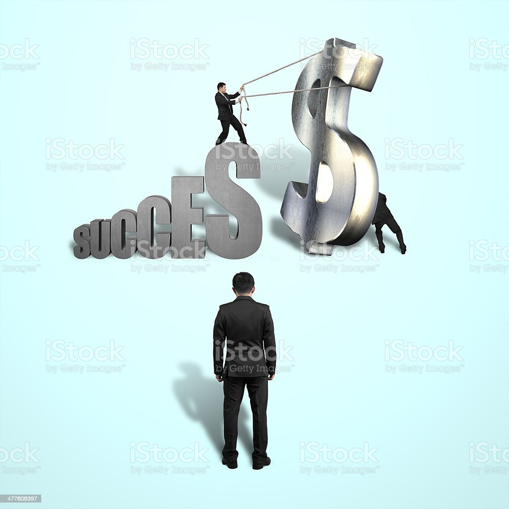 Trying to stand large money symbol for success royalty-free stock photo