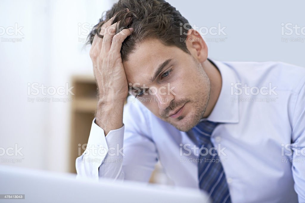 Trying to wrap his head around this problem stock photo
