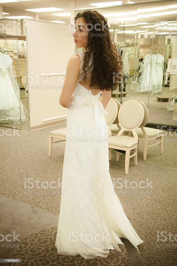 Trying Wedding Dress royalty-free stock photo