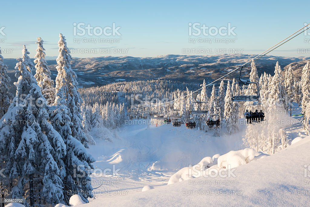 Tryvann ski resort with skiers taking the lift, Oslo Norway stock photo