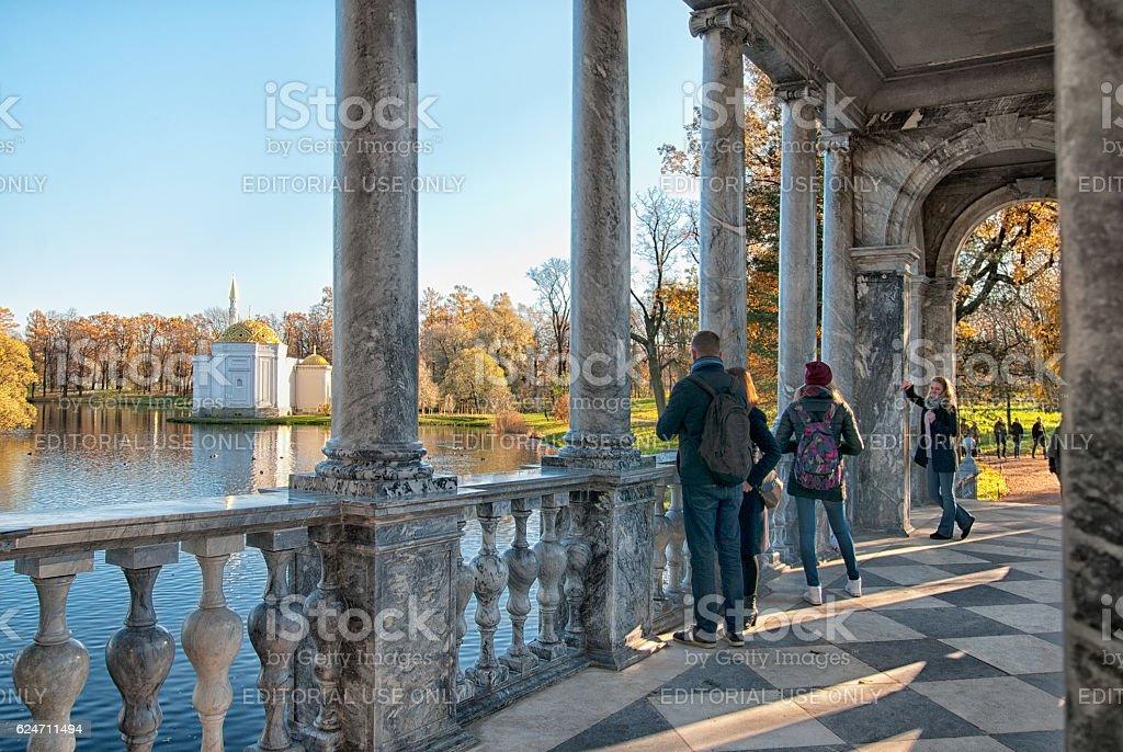 Tsarskoye Selo (Pushkin). Saint-Petersburg. Russia. People on The Marble Bridge stock photo