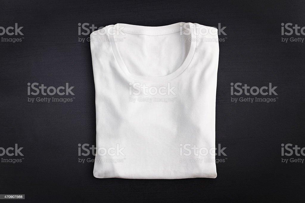T-shirt against chalkboard background stock photo