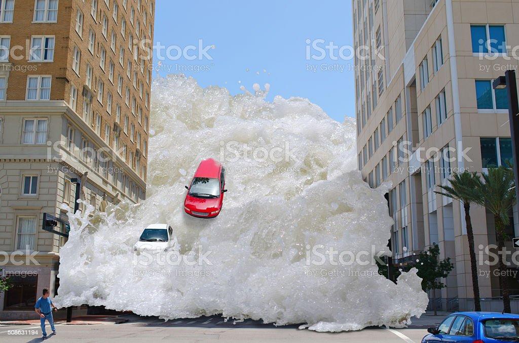 Tsunami tidal wave flash flood destroying city stock photo