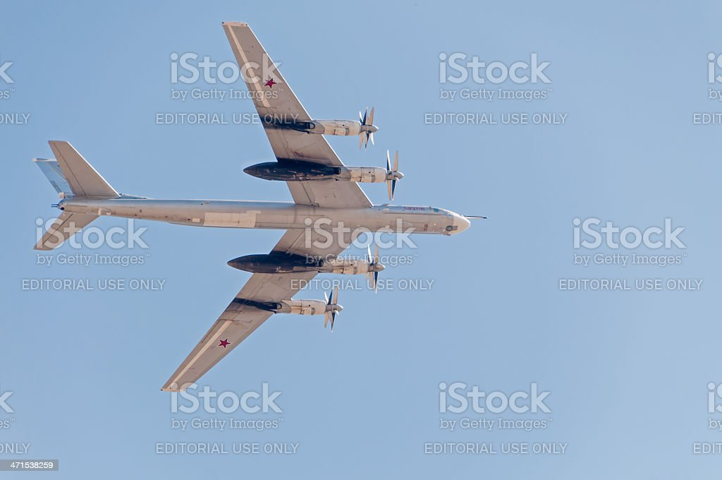 Tu-95 bomber and missile platform flies against blue sky background royalty-free stock photo