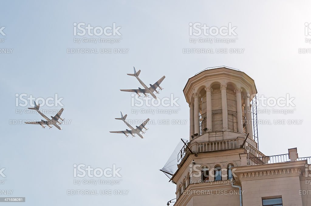 Tu-95 bomber and missile platforms fly against blue sky background royalty-free stock photo