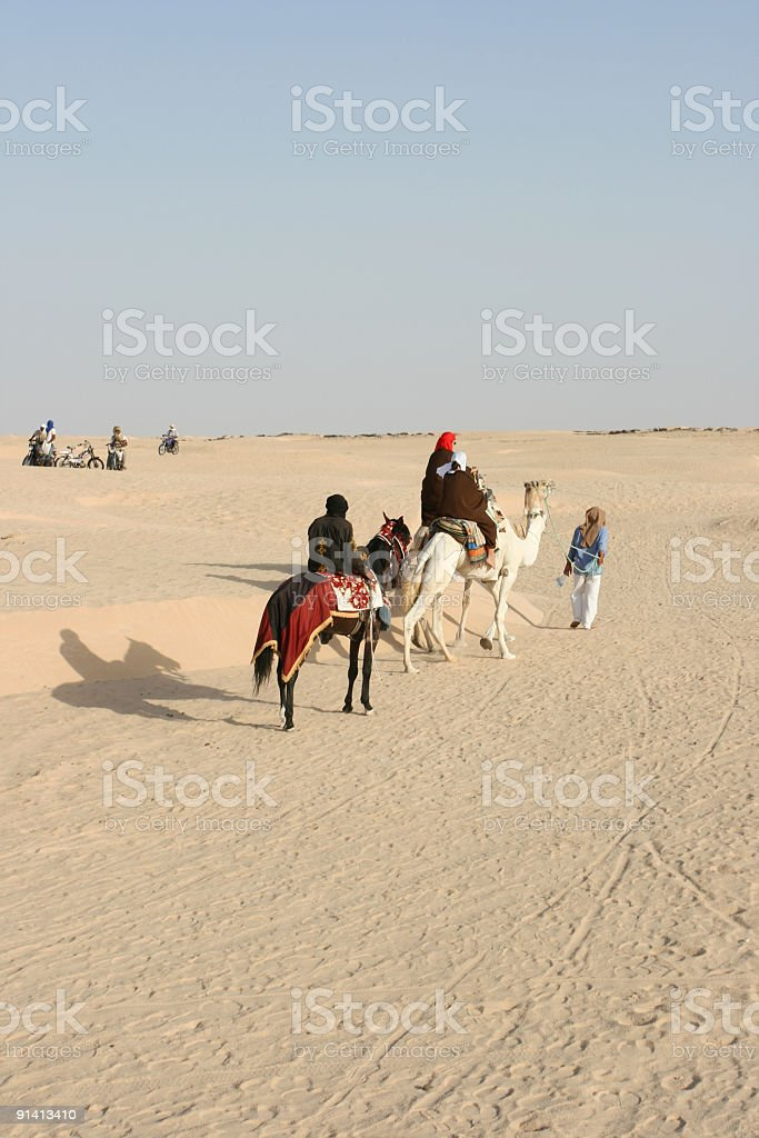 Tuareg and beduins in Sahara desert royalty-free stock photo
