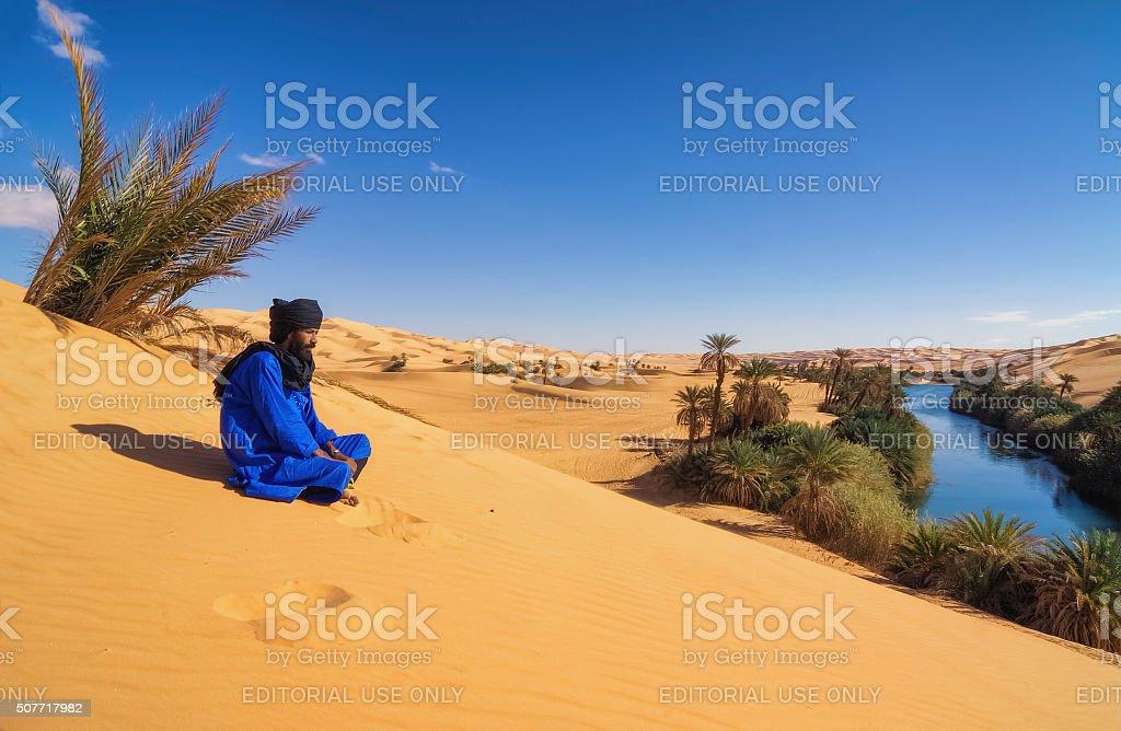 Tuareg on dune , Um el Ma , Mandara lake , Sahara, Libya stock photo