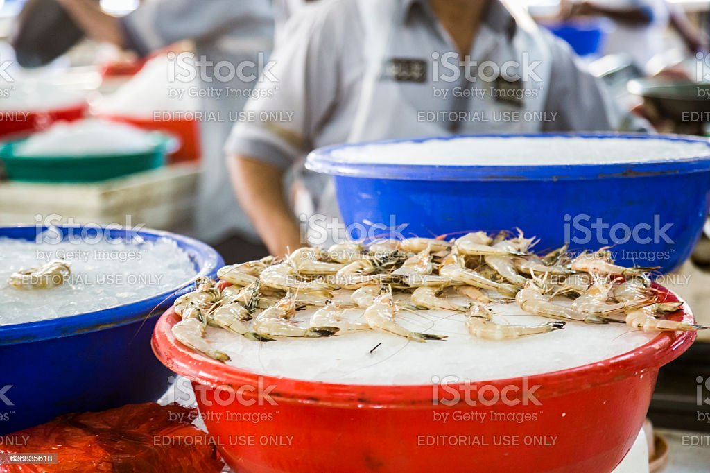 Tub of ice, with fresh shrimp on top. stock photo