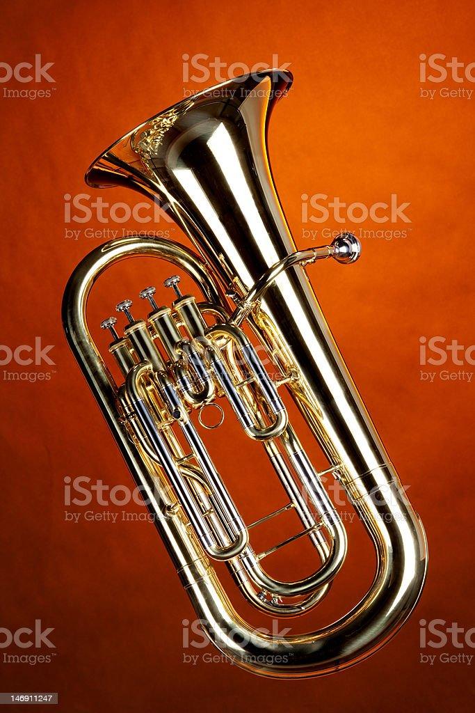 Tuba Euphonium Isolated On Gold stock photo