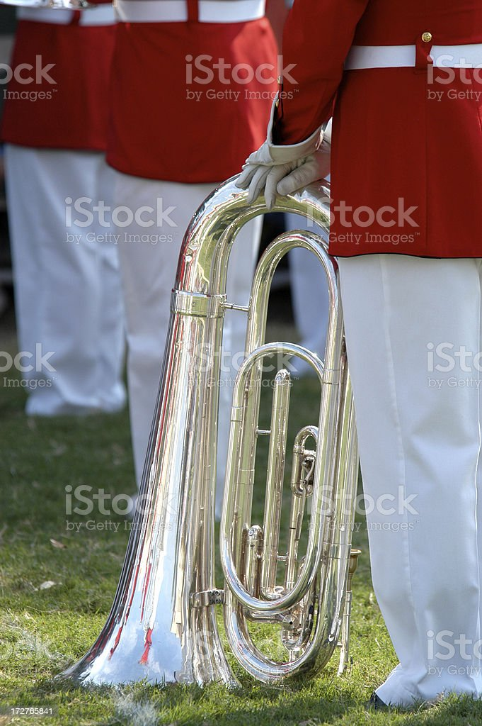 Tuba on ground as military band rests. royalty-free stock photo