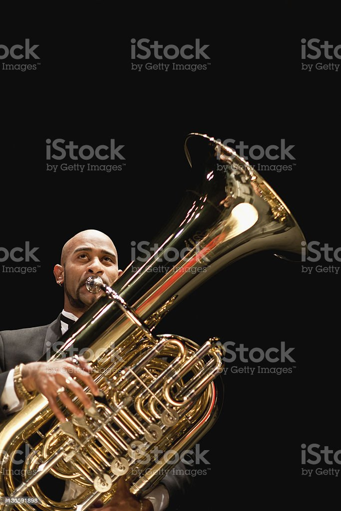 Tuba player in orchestra stock photo