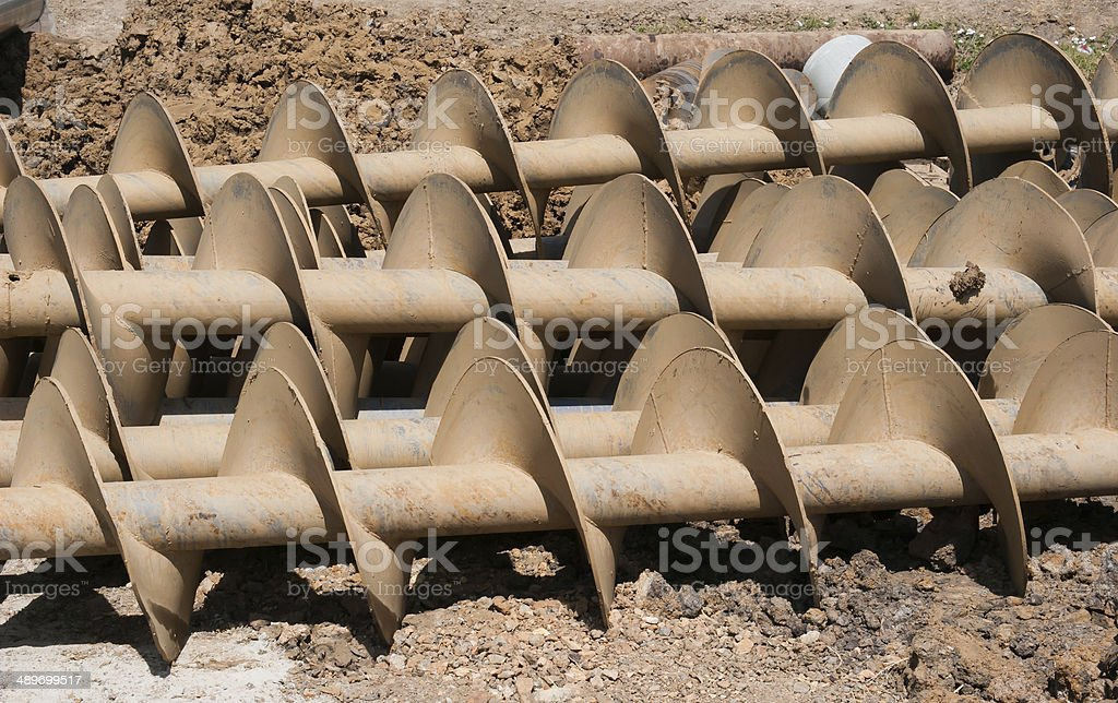 Tube of rust steel auger bunch before hot-dip galvanized. stock photo