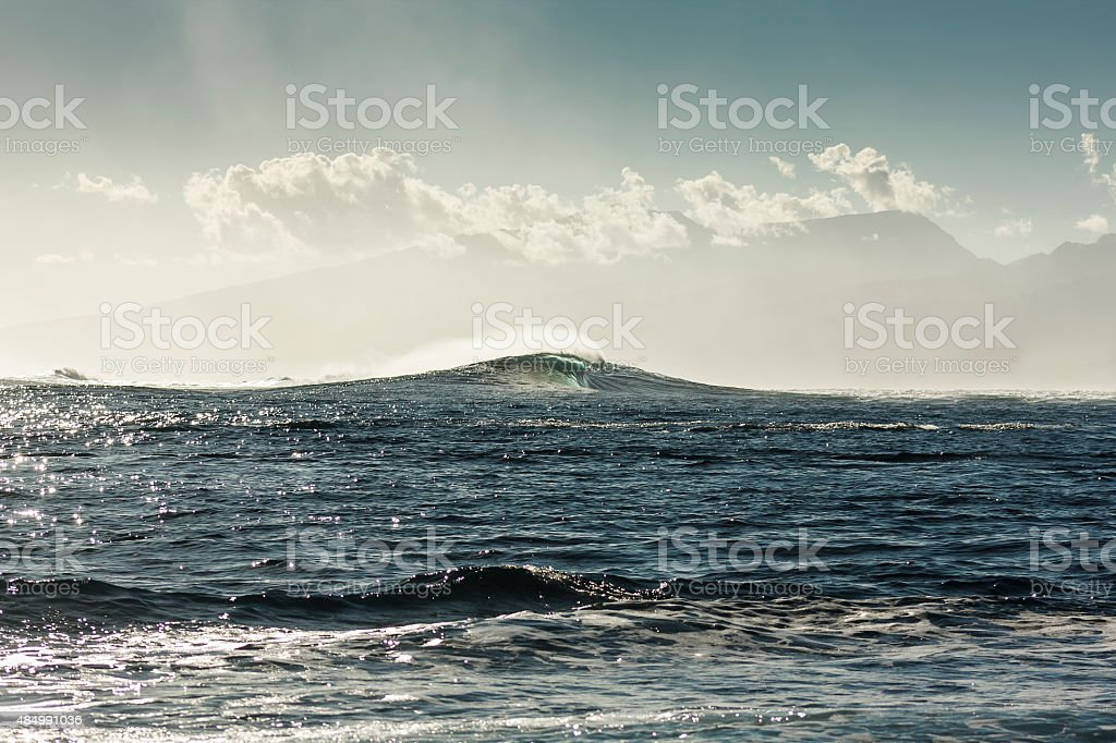 Tube Wave in Formation at Teahupoo Beach stock photo