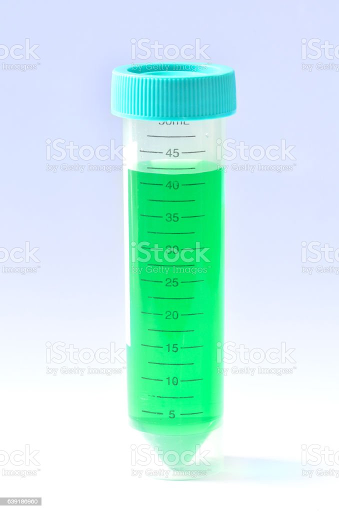 Tube with green toxic chemical stock photo