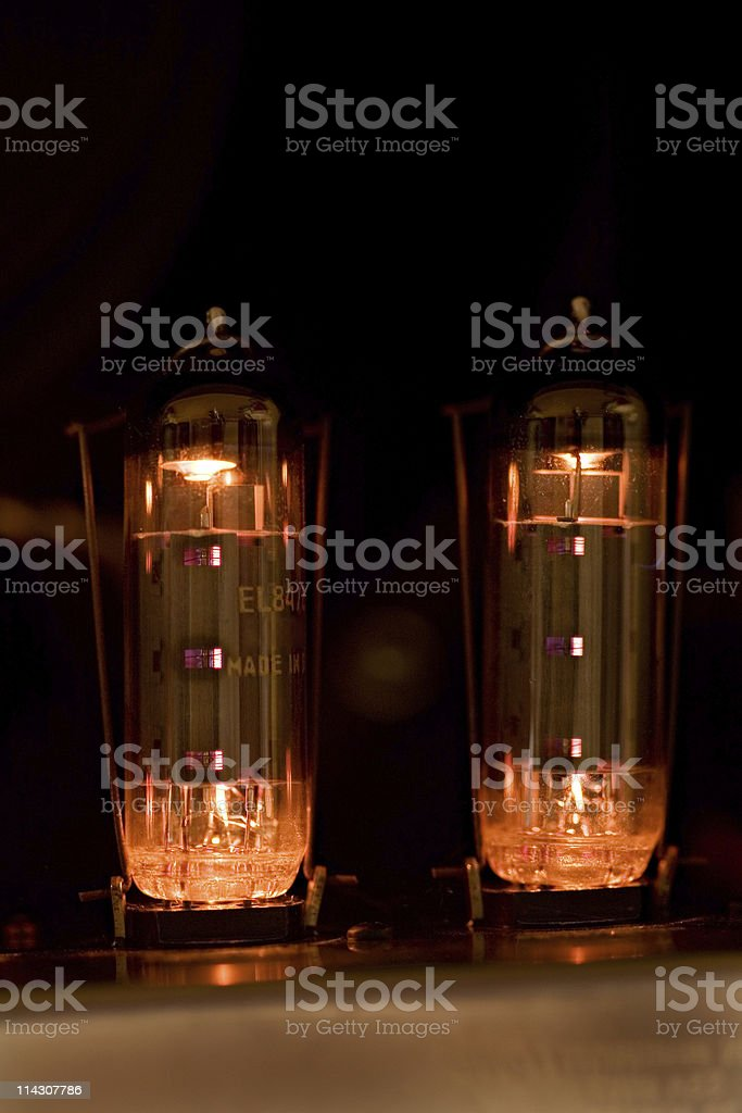 Tubes glow in guitar amplifier stock photo