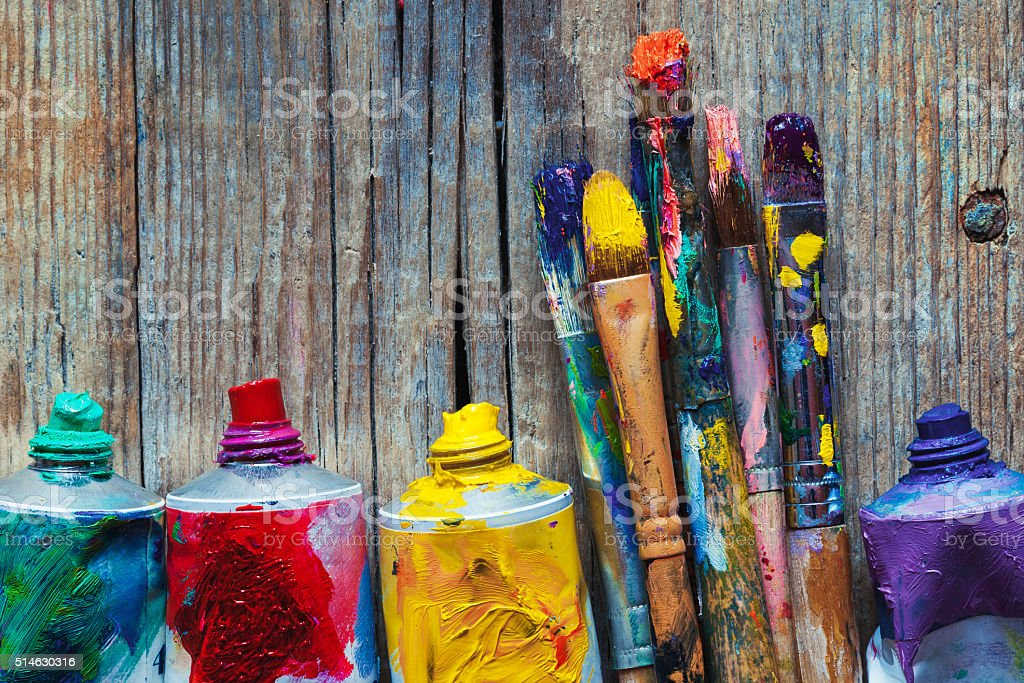 Tubes of oil paint and artist paint brushes closeup stock photo