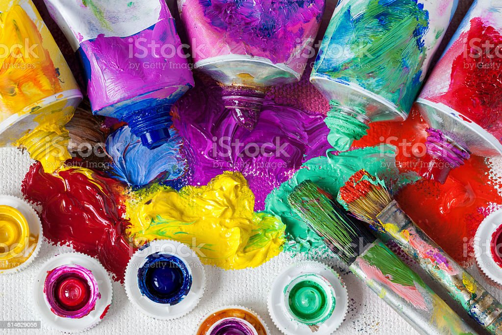 Tubes of oil paint, palette and artist paintbrushes stock photo