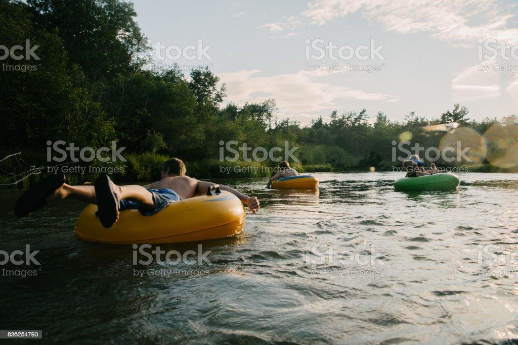 Tubing in river stock photo
