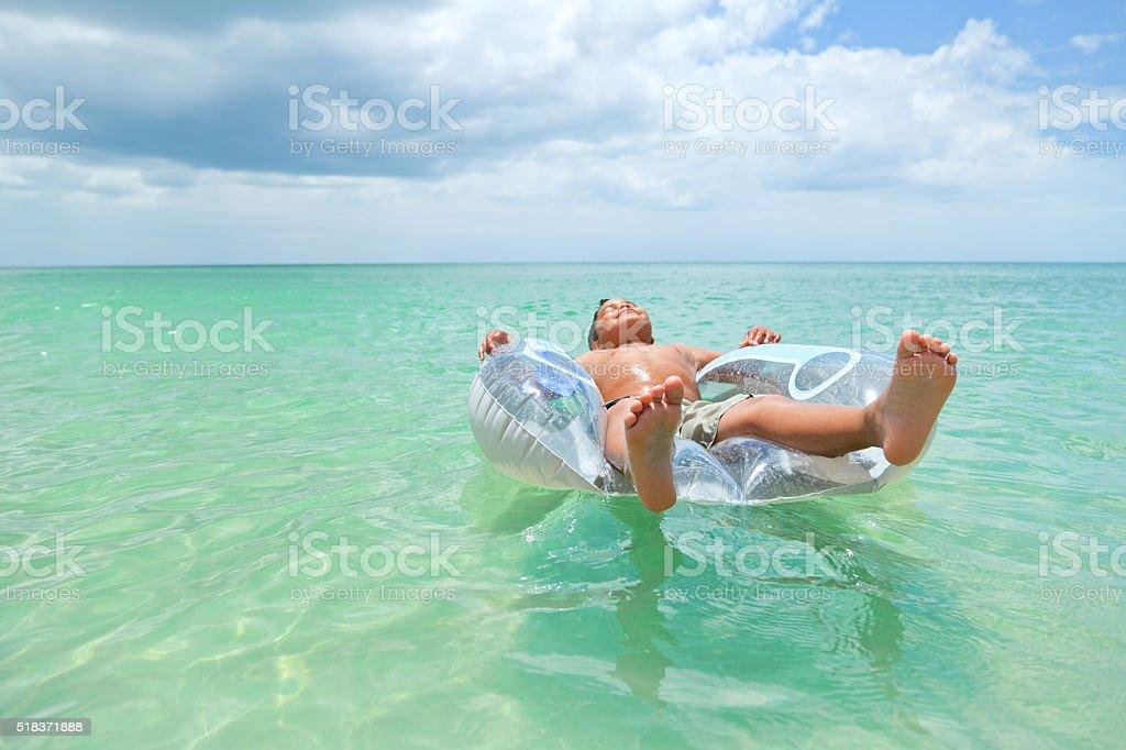 tubing in the sun stock photo