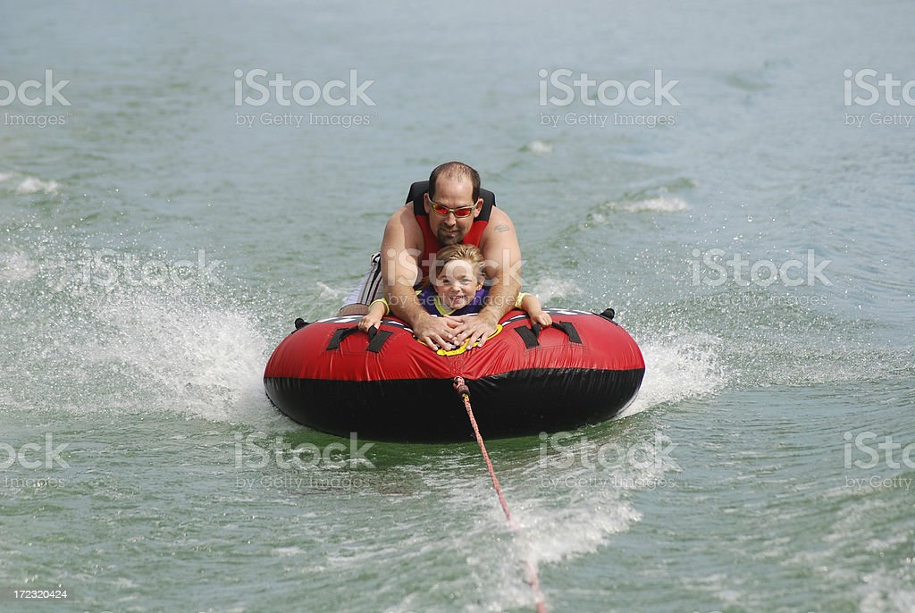 Tubing with Dad stock photo