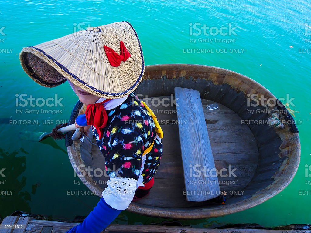 Tub-shaped boat woman stock photo