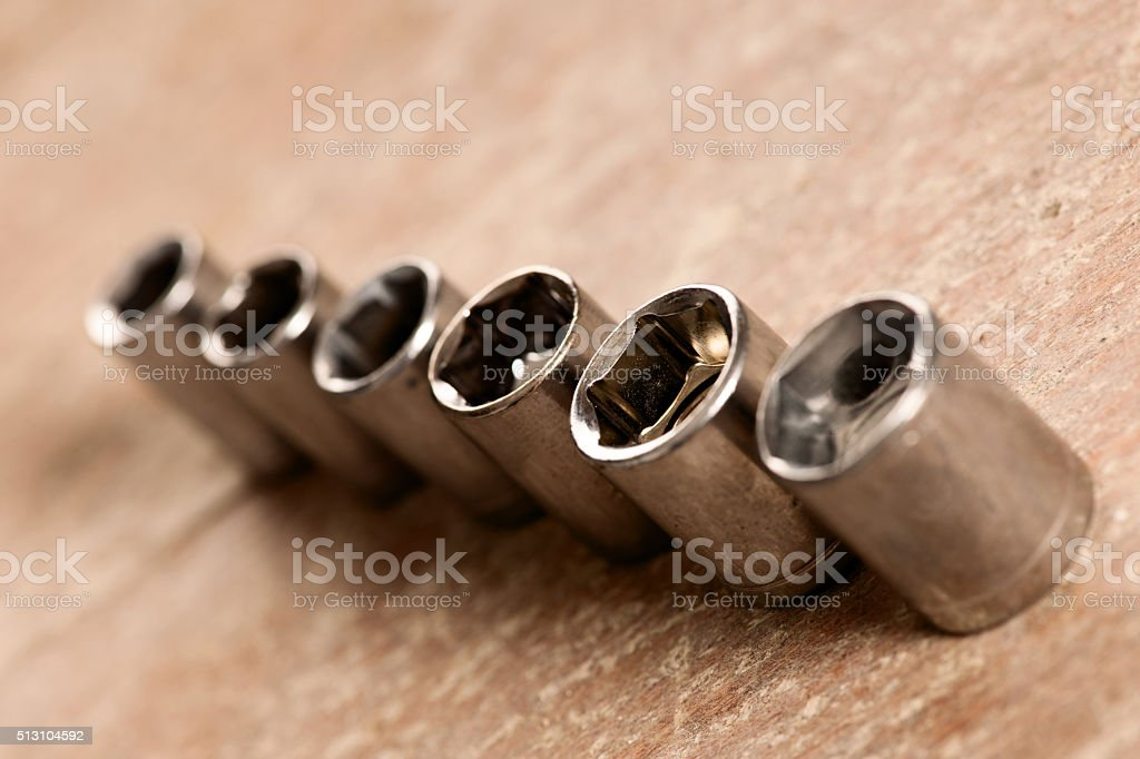 Tubular socket tools for spanner wrench standing in row stock photo