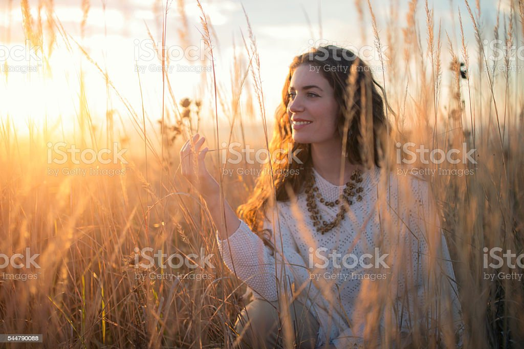 Tucked in the soft grass stock photo
