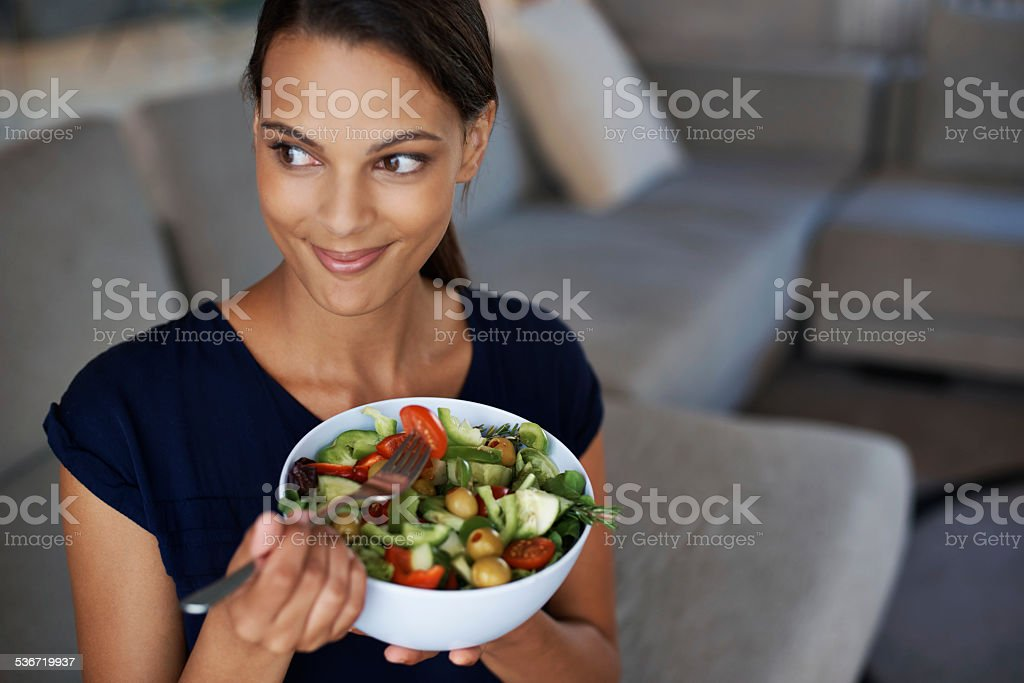 Tucking in to something healthy stock photo