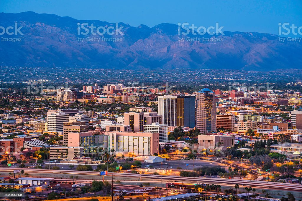 Tucson Arizona skyline cityscape and Santa Catalina Mountains at dusk stock photo